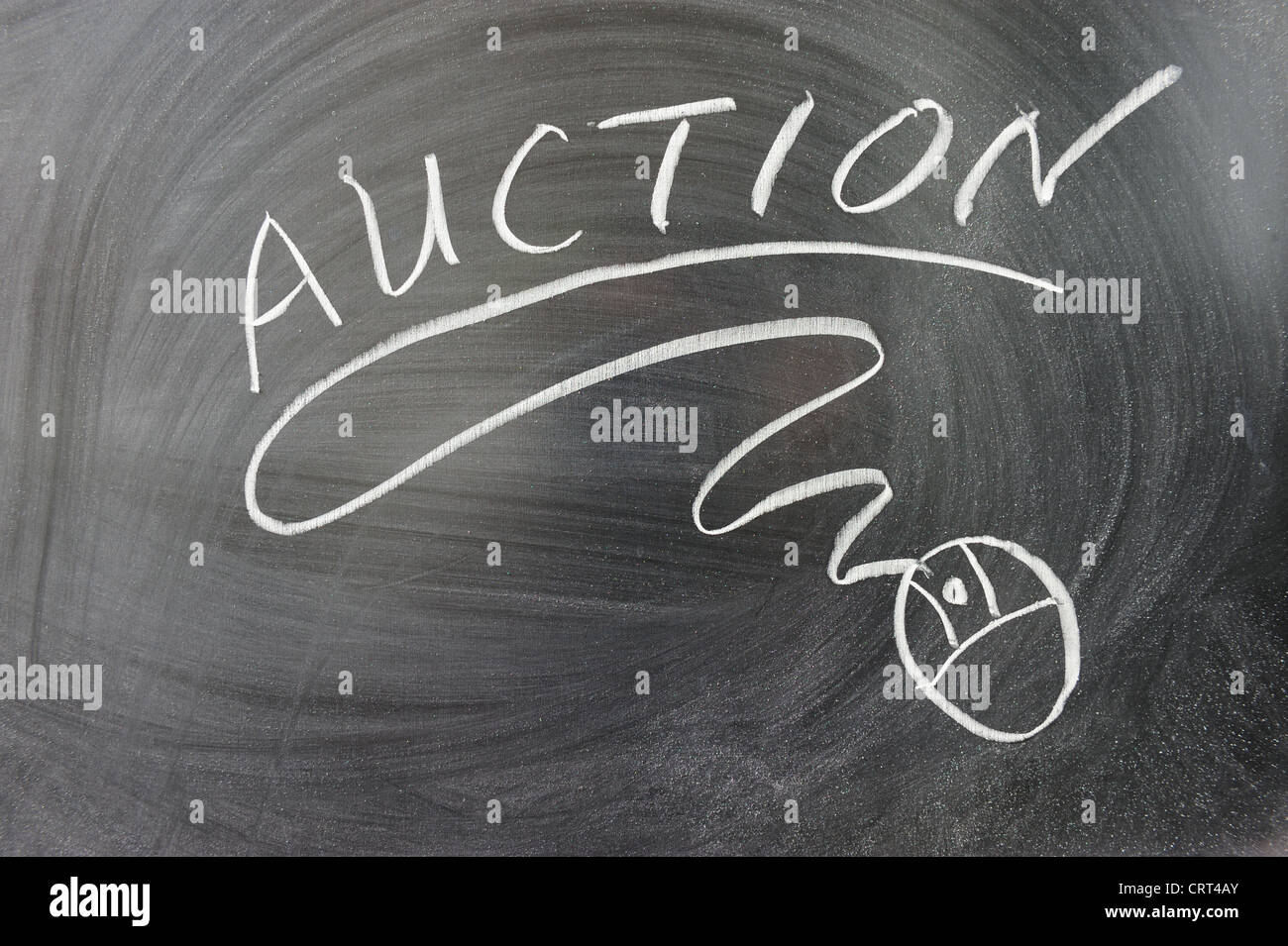 Auction word and mouse symbol on the chalkboard - Stock Image