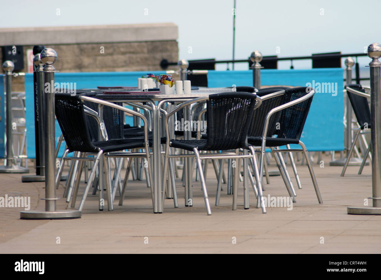Scenic view of vacant seats in outdoor café. - Stock Image