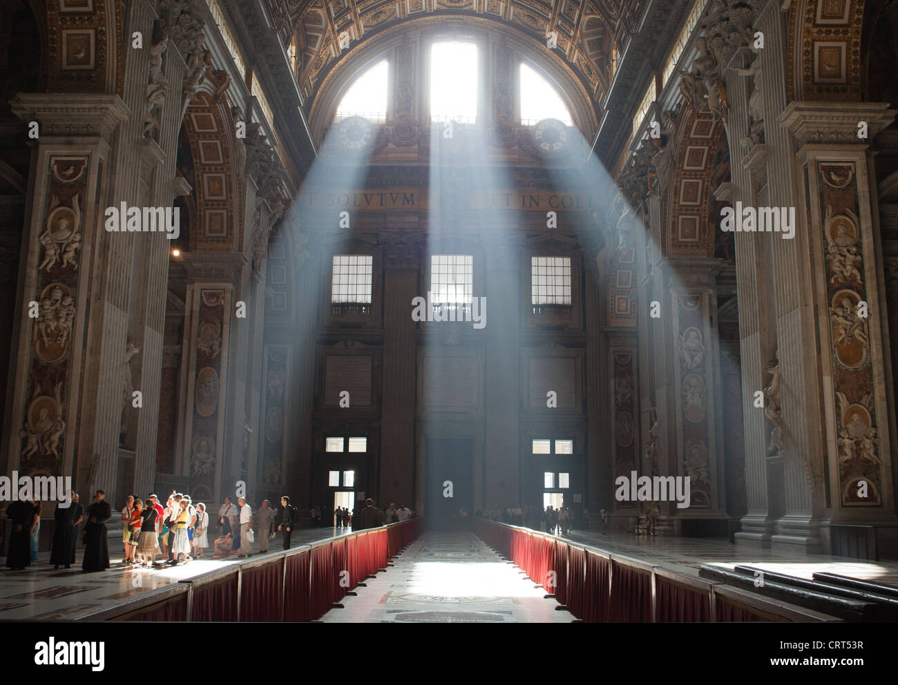 Crepuscular rays are seen in St. Peter's Basilica in the Vatican City. - Stock Image