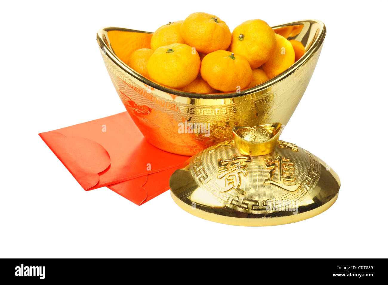 Chinese New Year Mandarin Oranges in Gold Ingot Container and Red Packets on White Background - Stock Image