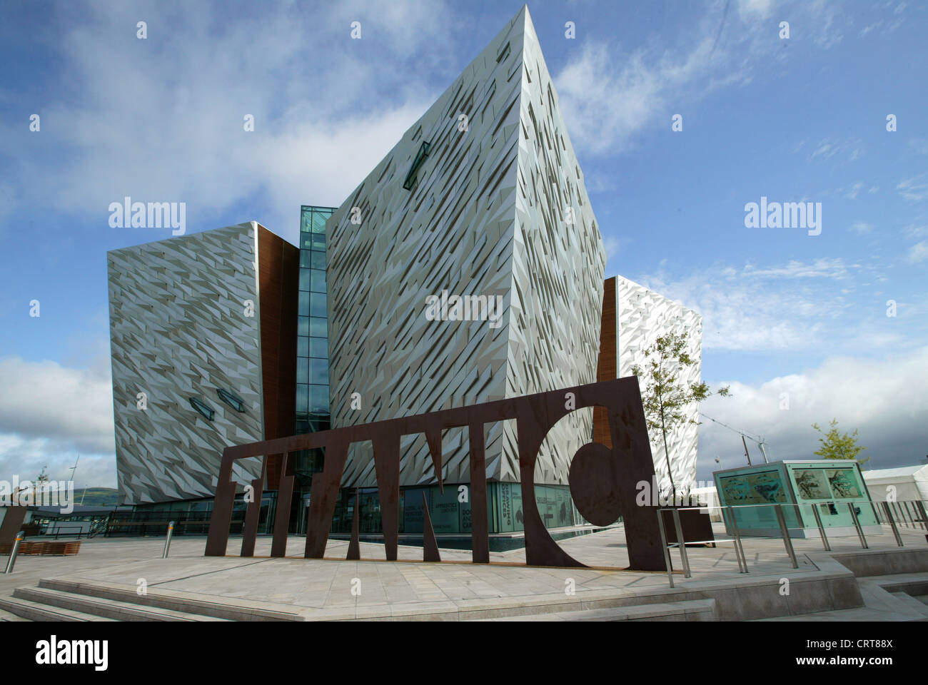 Elevated side view of Titanic Belfast visitor center, Titanic Building, Titanic name cut from sheet steel,  Aluminum Stock Photo