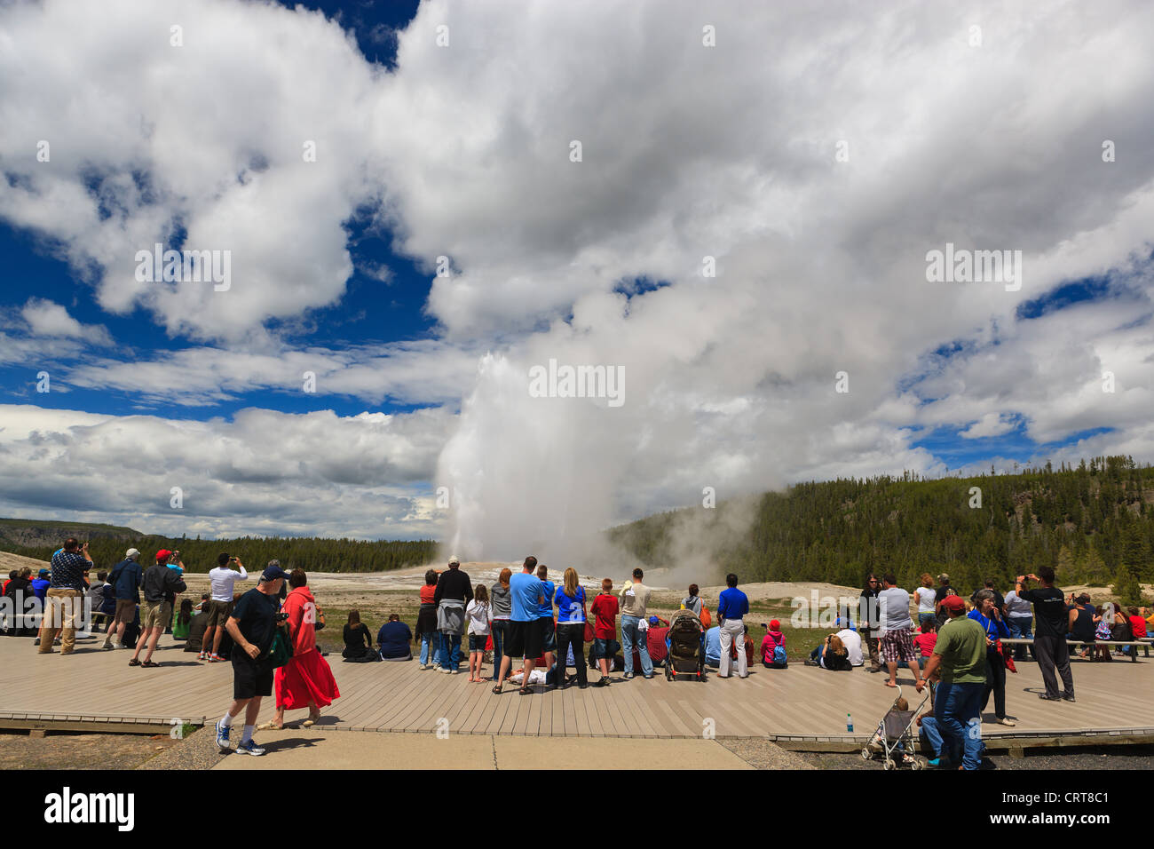 People watching Old Faithfull geyser in Yellowstone National