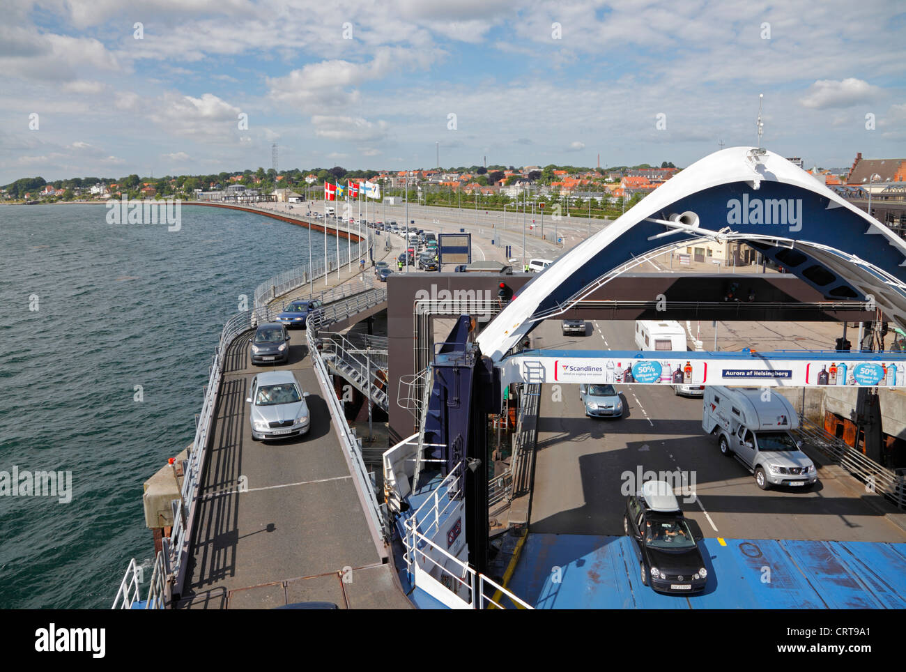 Cars and vehicles driving on board the Scandlines ferry M/V AURORA in Elsinore, Denmark, for the 20 minutes passage - Stock Image