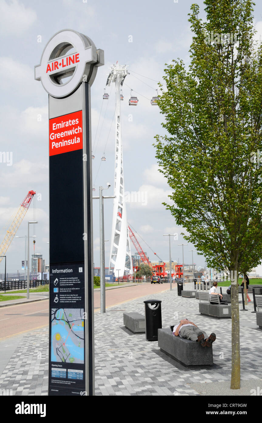 Sign for Emirates Air Line sponsored cable car service crossing the River Thames between Greenwich Peninsula and Stock Photo