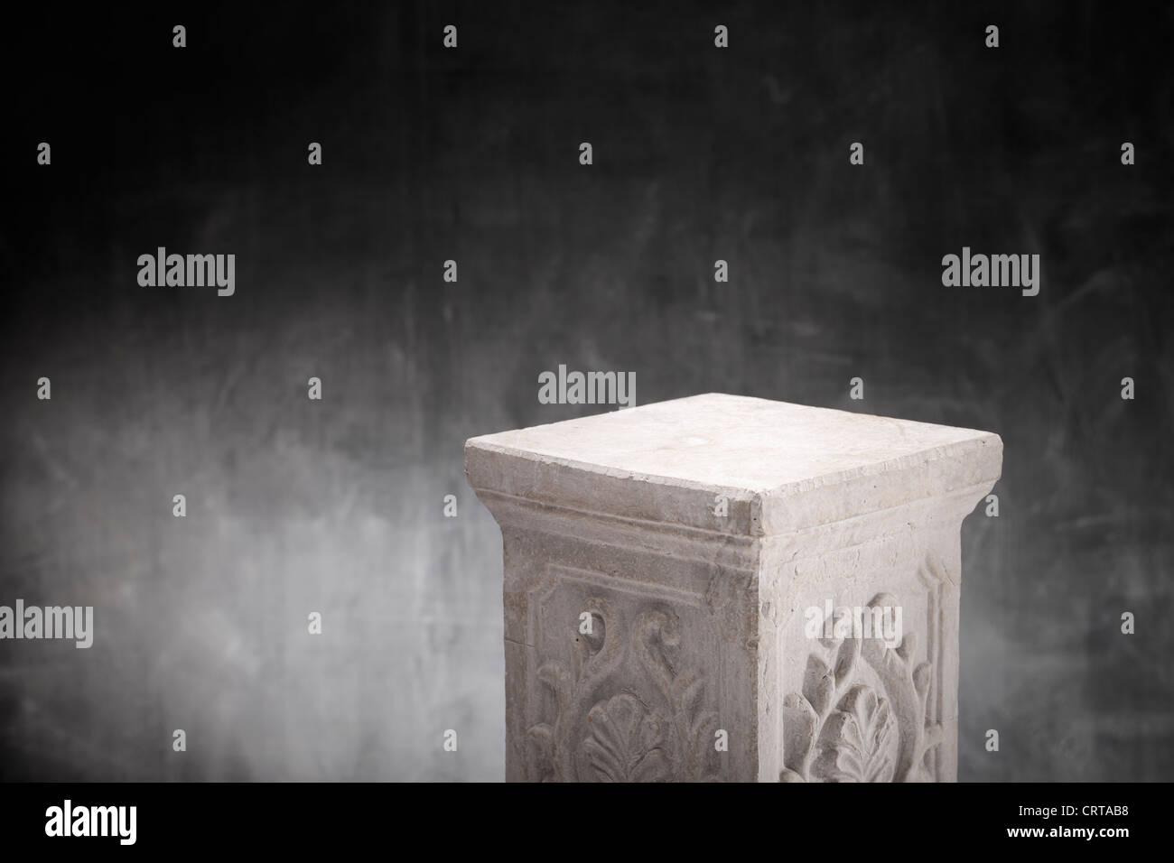 A Plaster column with nothing on top. - Stock Image