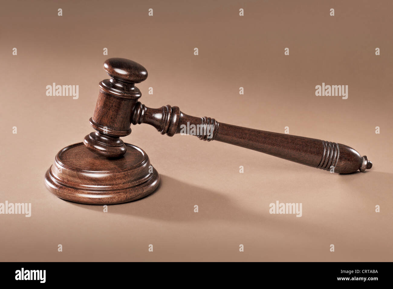 A Mahogany wooden gavel with sound block. - Stock Image