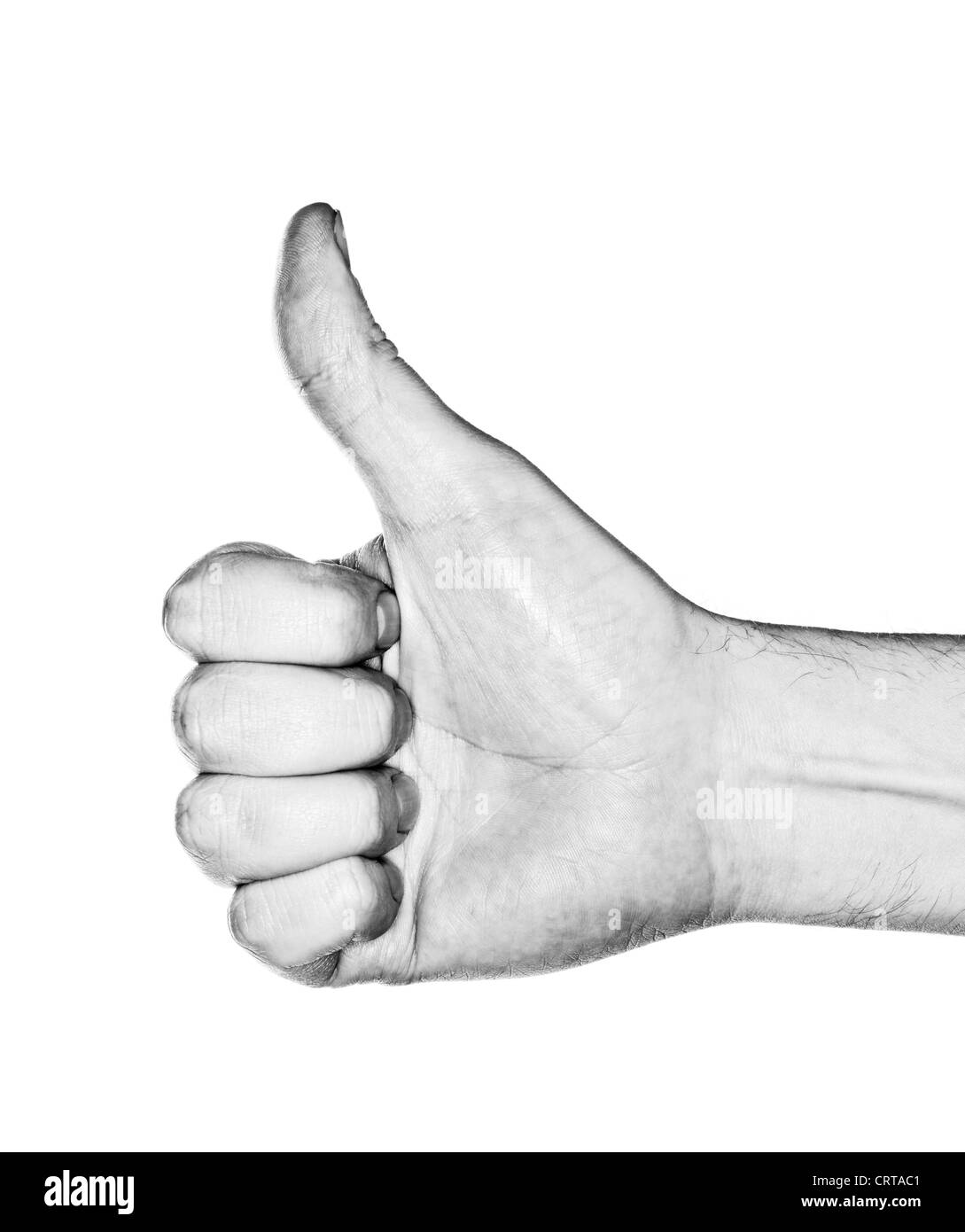 Black and white image of a hand making a 'thumb up' gesture. Photographed with ring flash. - Stock Image