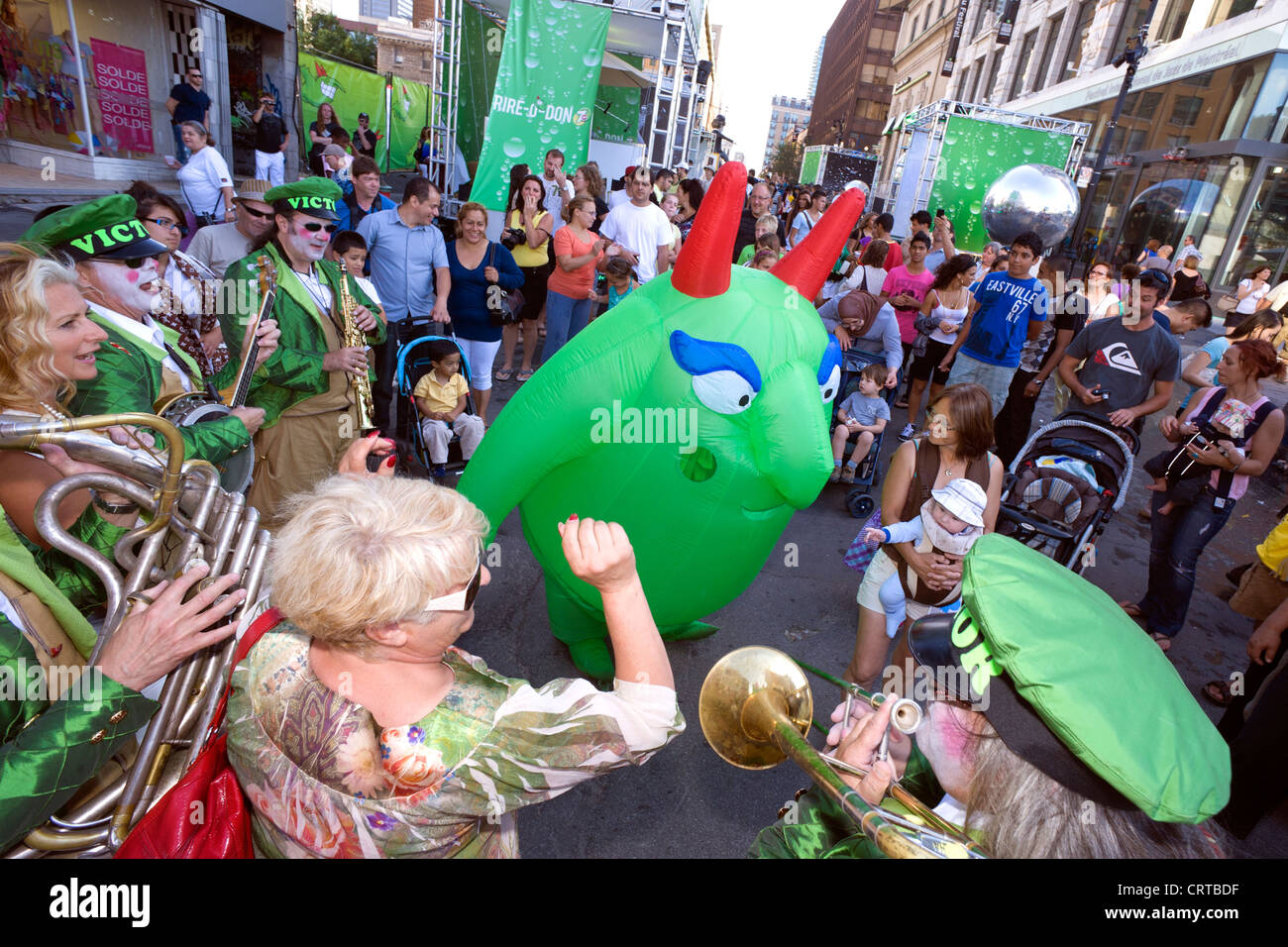 Victor the mascot dancing amongst the crowd during the Just for Laughs Festival in Montreal, province of Quebec, - Stock Image