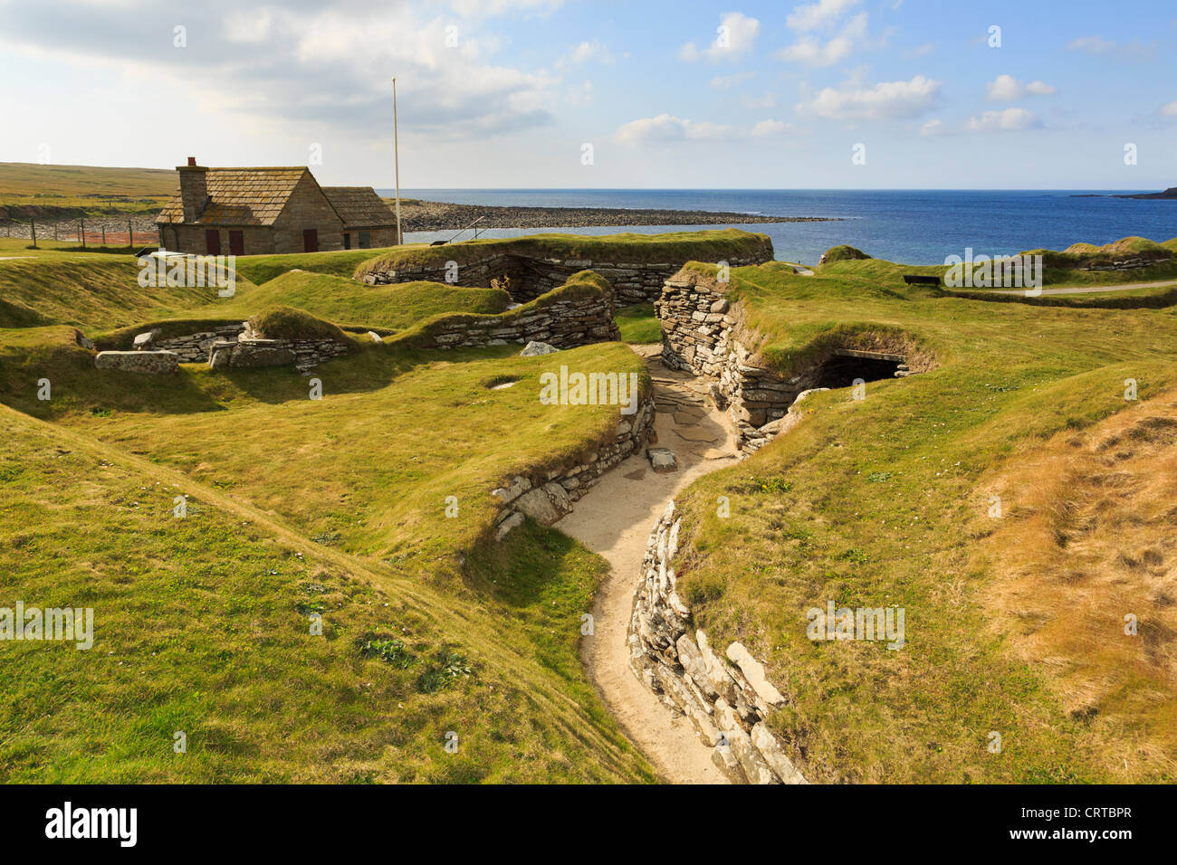 Excavations of tunnel between prehistoric houses in Neolithic village at Skara Brae by Bay of Skaill Orkney Islands - Stock Image