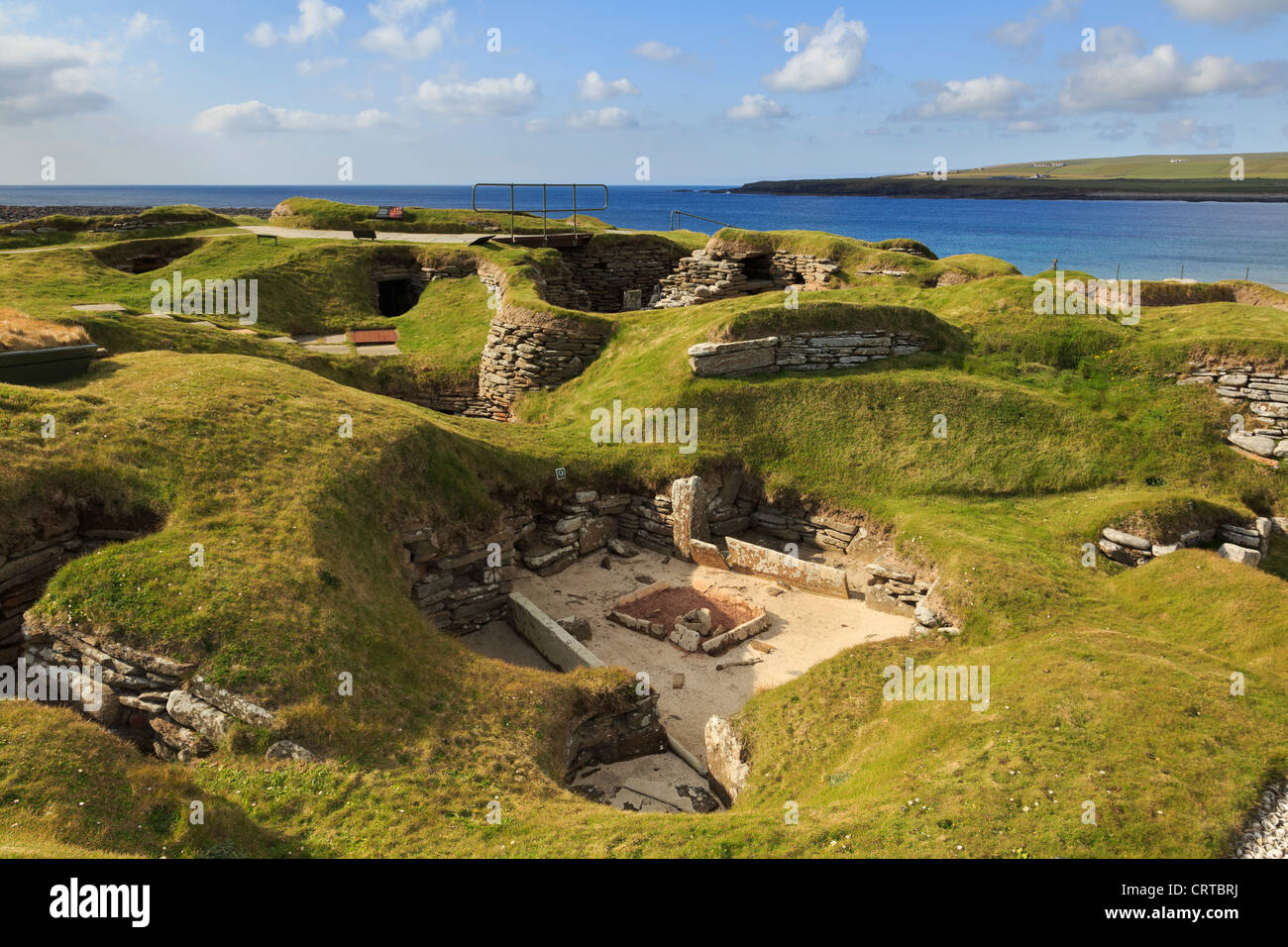 Excavations of ancient prehistoric houses in Neolithic village at Skara Brae by Bay of Skaill Orkney Islands Scotland - Stock Image