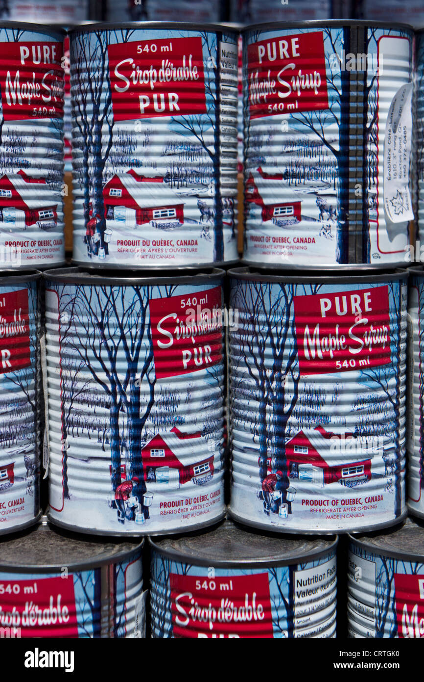 Cans of maple syrup at Jean Talon market. Montreal, Quebec, Canada. - Stock Image