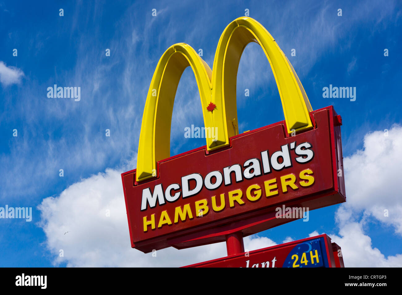 McDonald's Canada with small maple leaf in M sign. - Stock Image