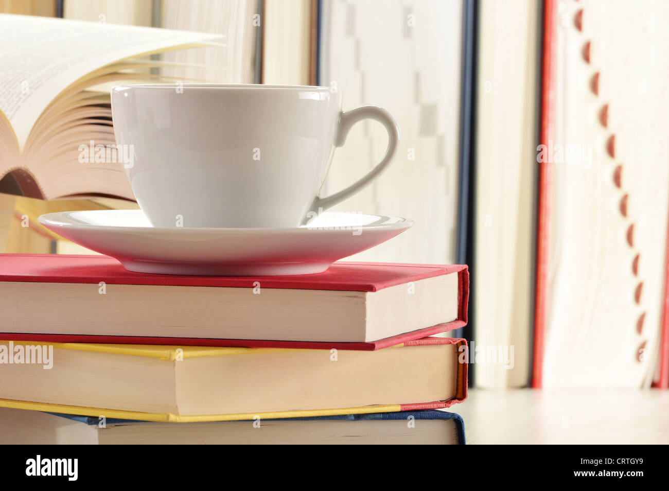 Composition with stack of books and cup of coffee Stock Photo