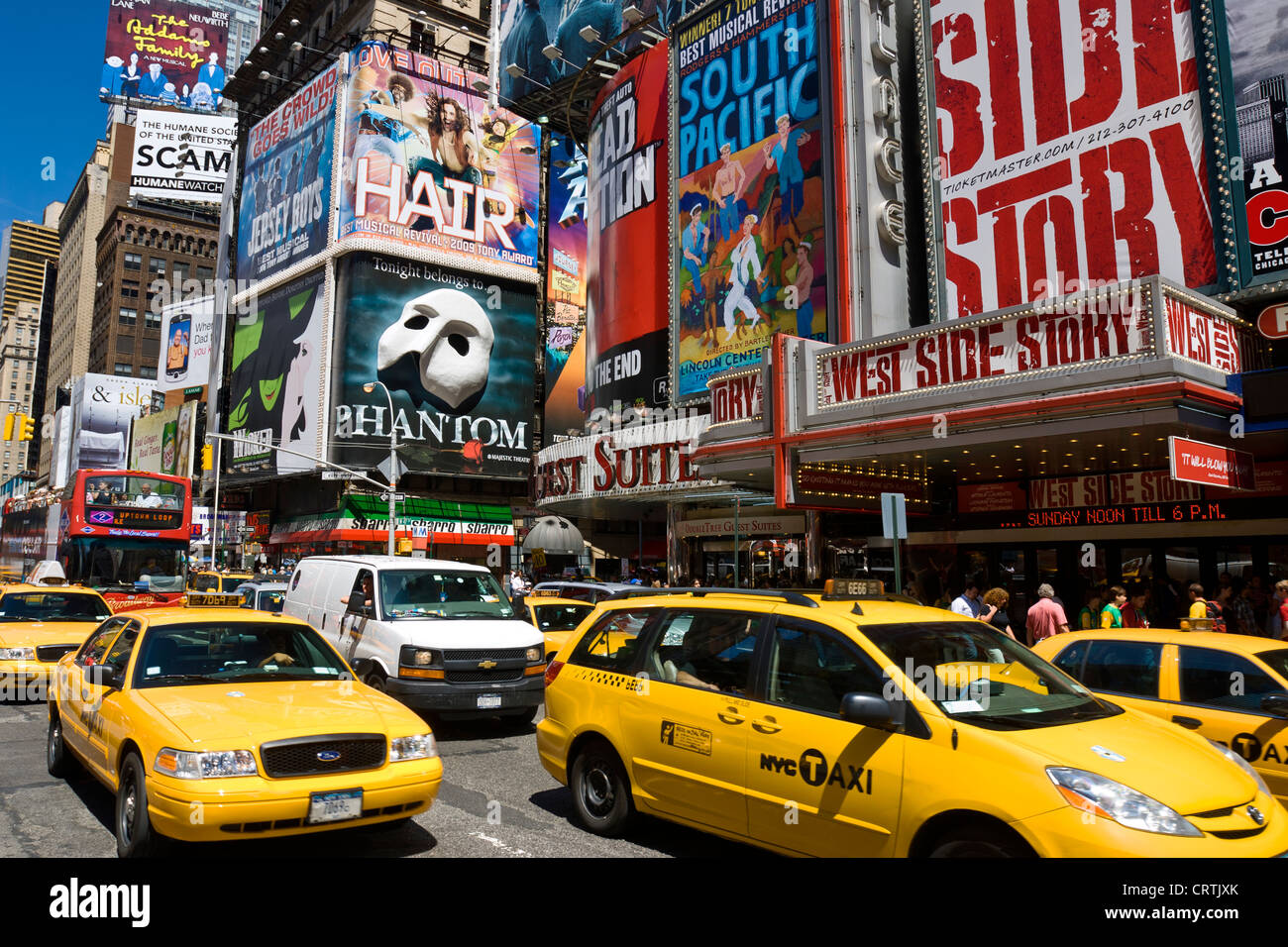 New York Times Square Yellow Taxi, New York City Daytime Broadway Theater Billboards and Yellow Taxis - Stock Image