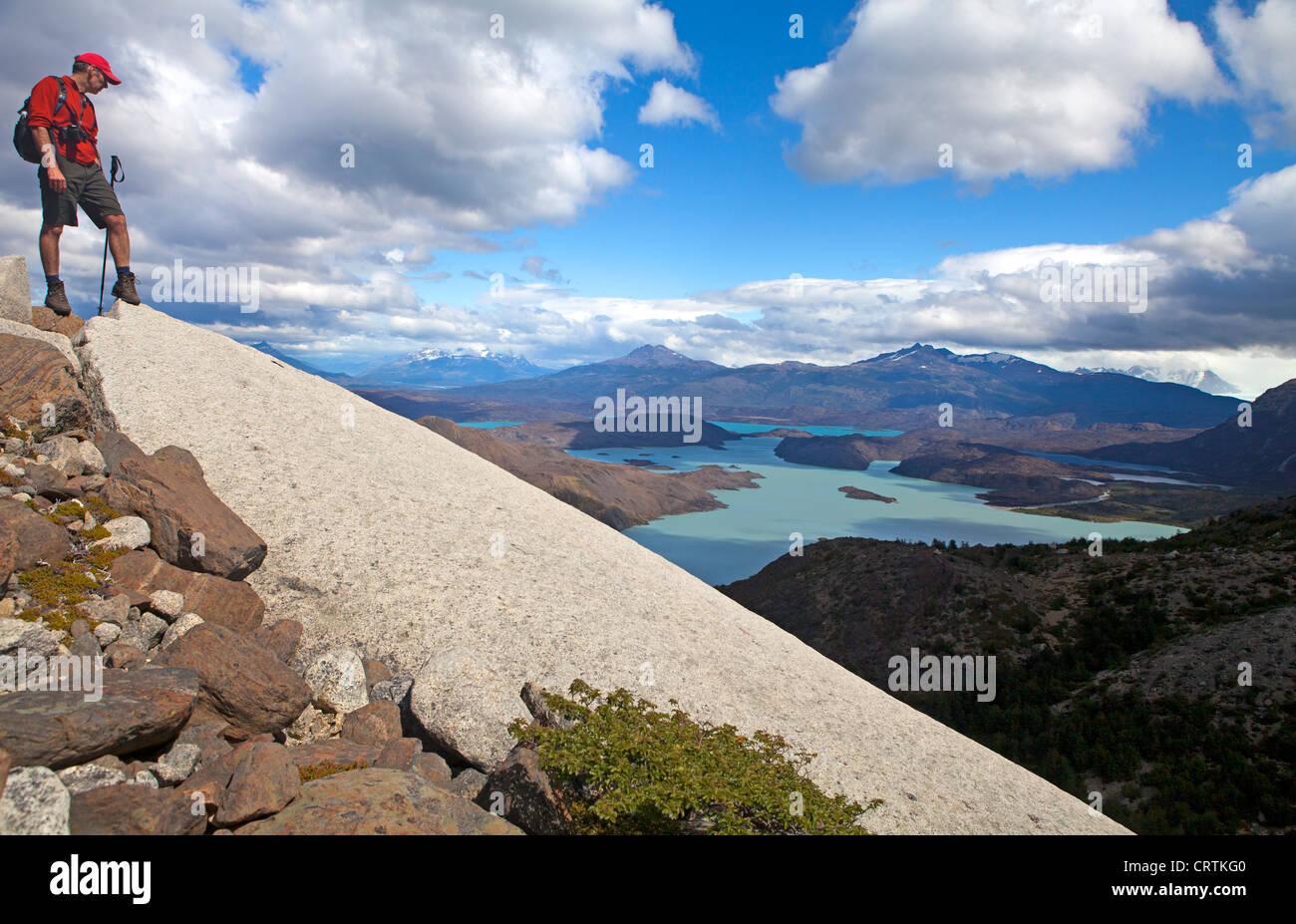 Hiker above Lago Nordenskjold in Torres del Paine National Park Stock Photo