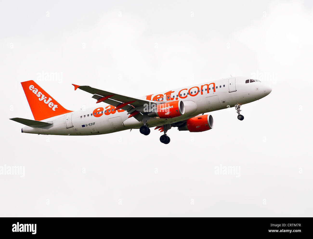 EasyJet Airbus A320-214 Airliner G-EZUF on Approach to London Gatwick Airport West Sussex England United Kingdom - Stock Image