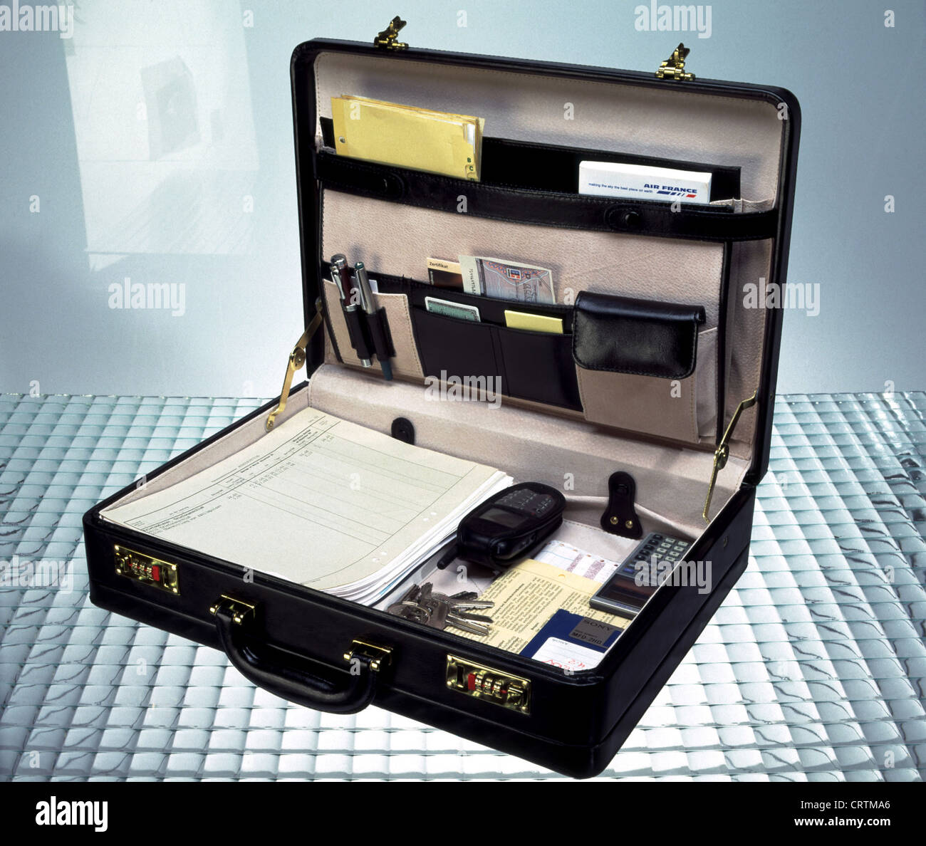 half off 2d5ef 7a768 Briefcase with cell phone and Bueroutensilien Stock Photo: 49100638 ...