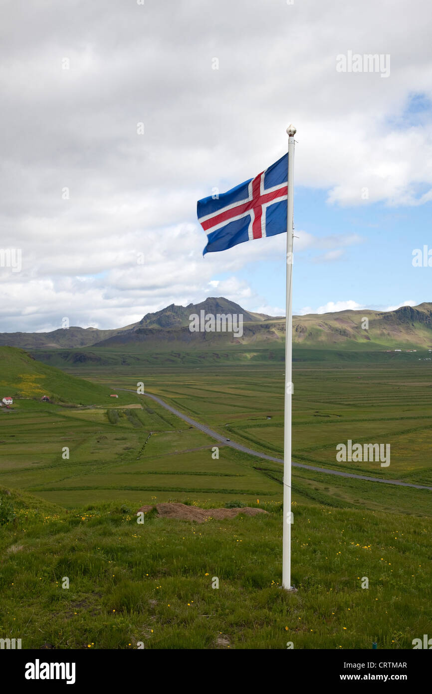 Icelandic flag. The national flag of Iceland on a flagpole overlooking the main south coast road to Vik - Stock Image