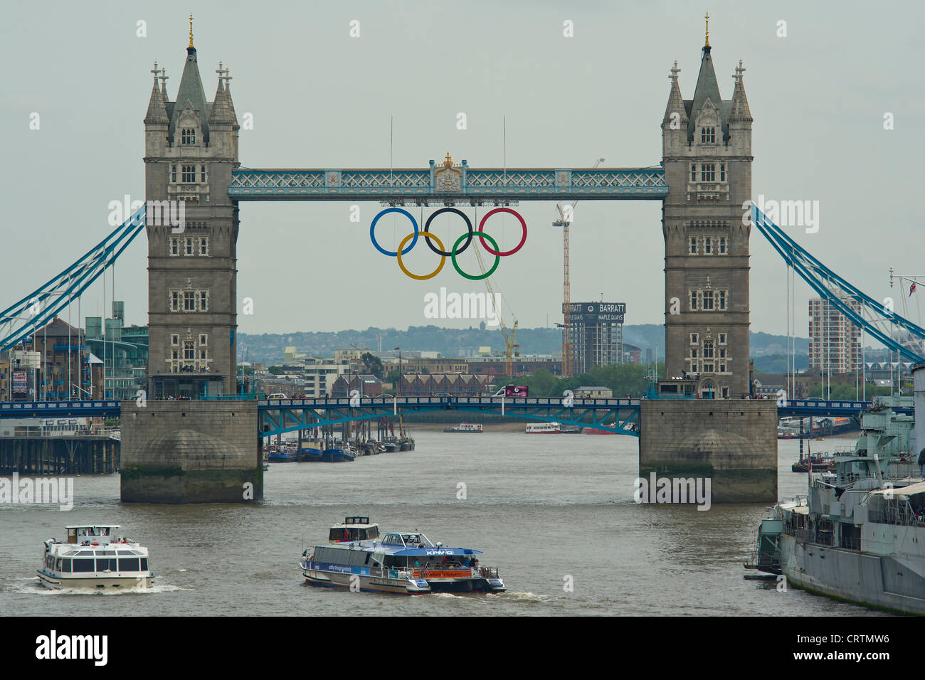 The giant Olympic Rings are unveiled on Tower Bridge, London, UK. - Stock Image