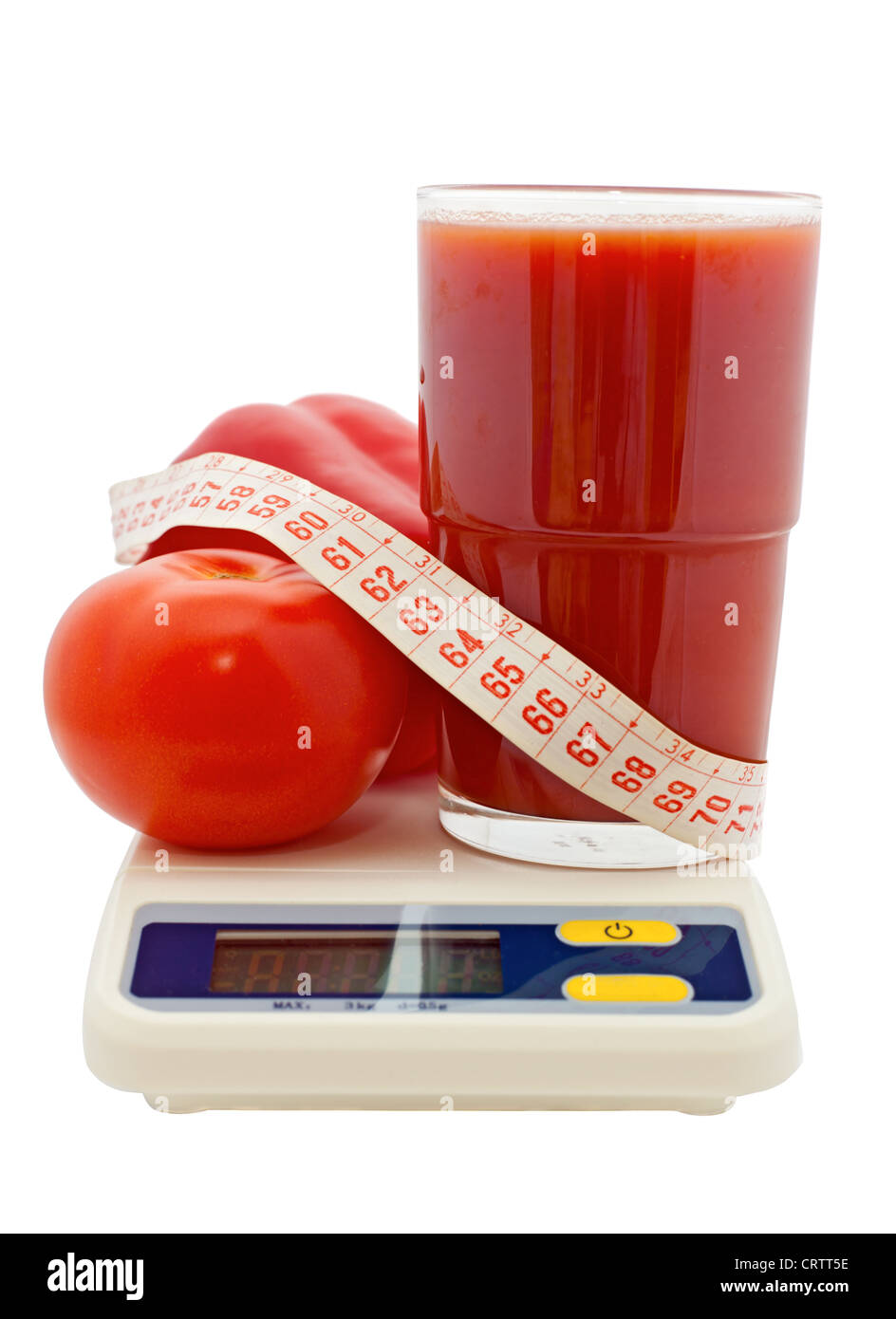 tomato juice, vegetables, measuring tape on electronic scale - Stock Image