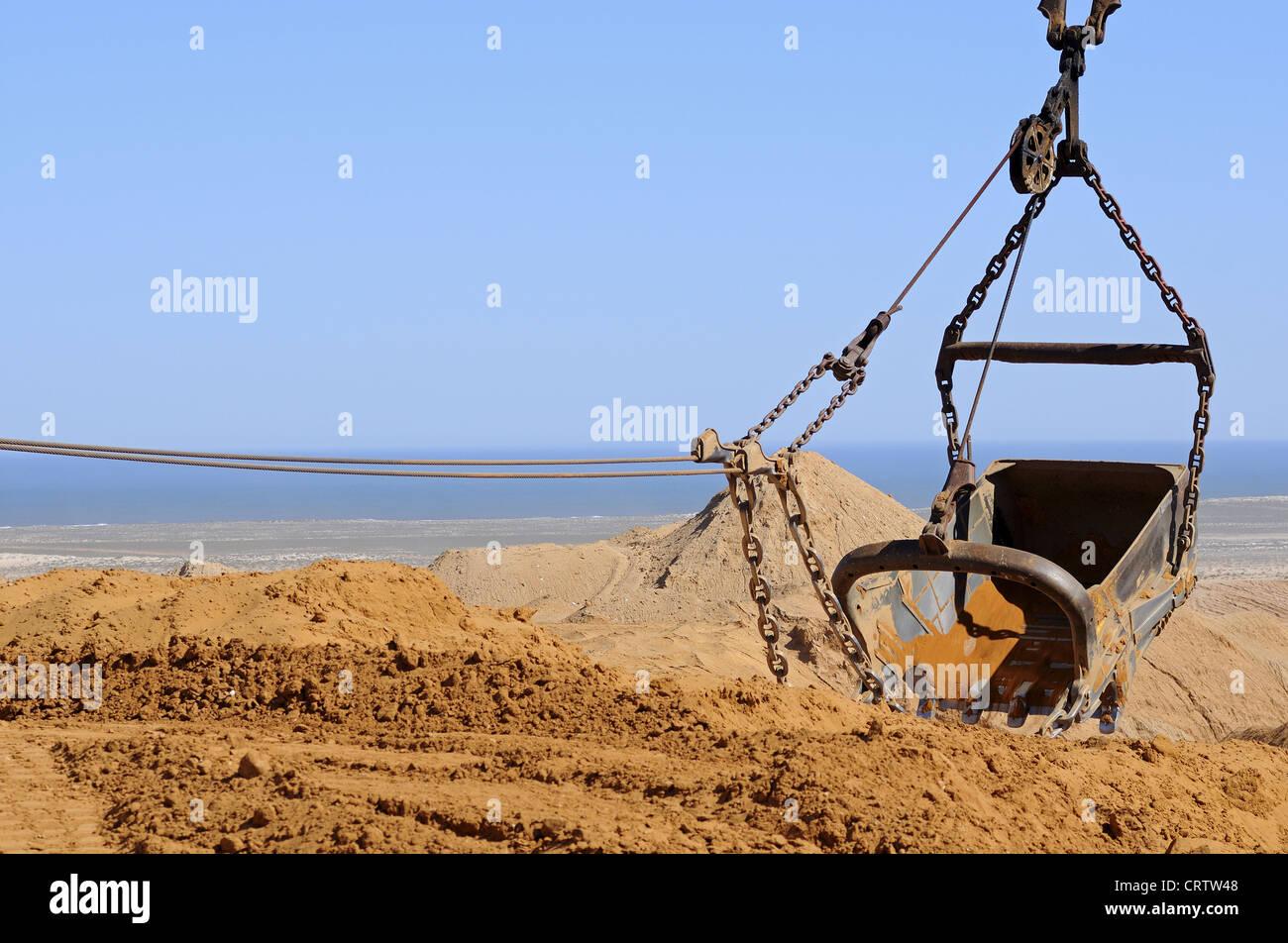 dragline excavator dumping excavated material Stock Photo