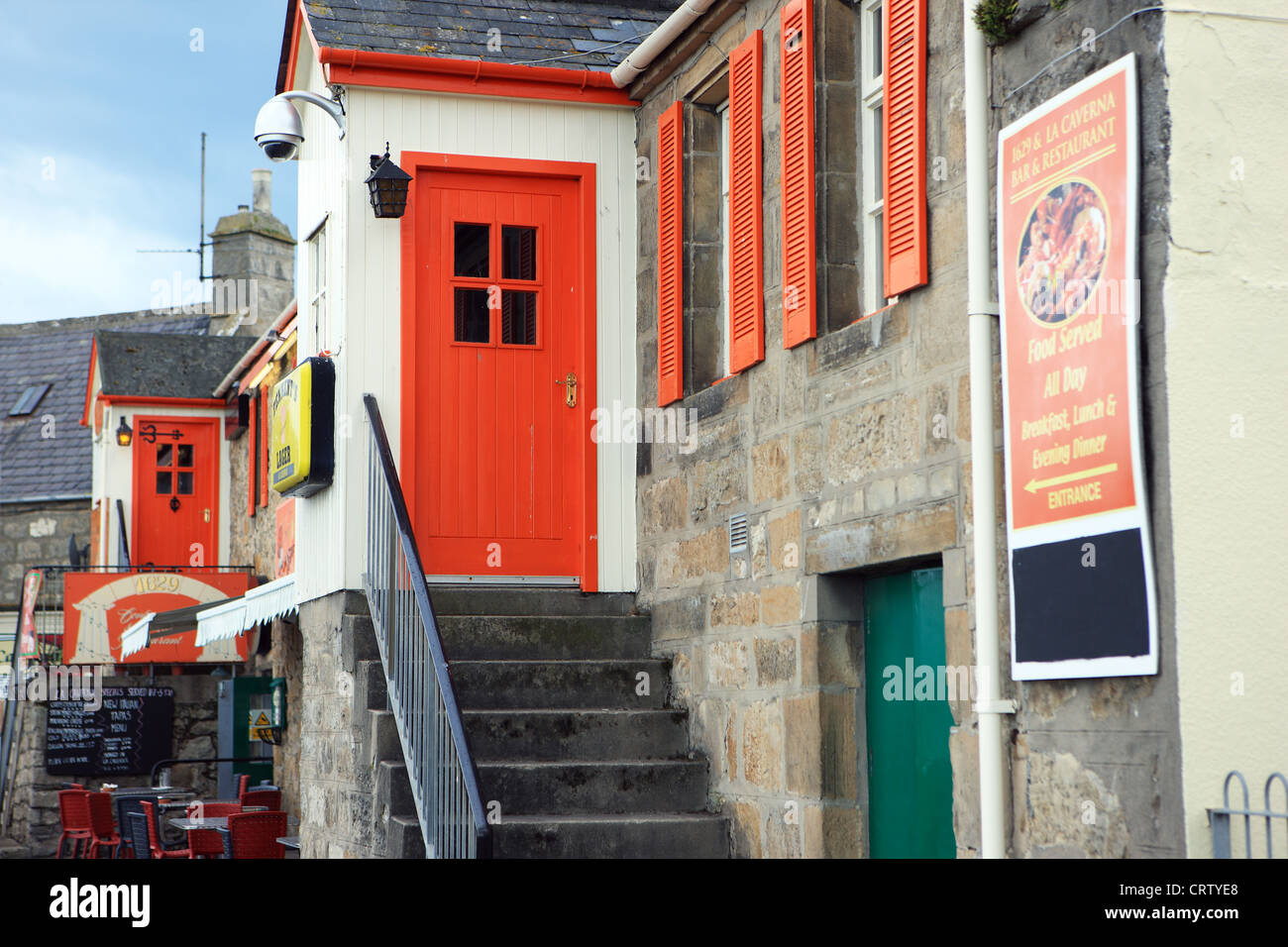 Bright coloured doors and windows of the 1629 restaurant in Lossiemouth in Scotland - Stock Image
