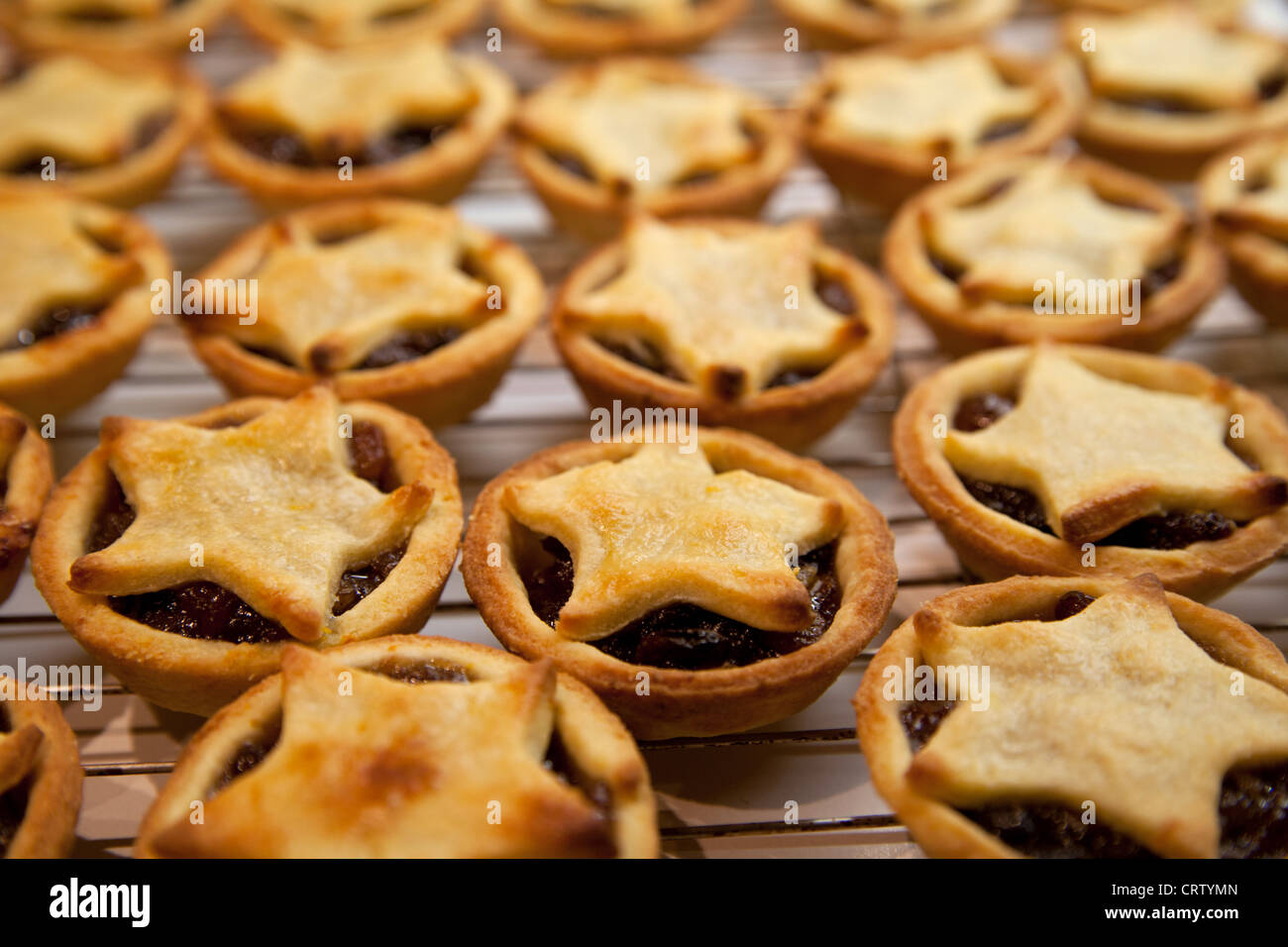 Decorative mince Pies Christmas on wire tray. - Stock Image