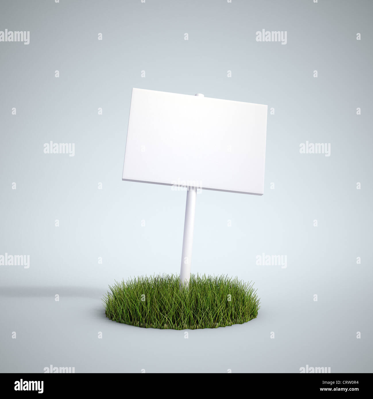 An empty sign on a patch of grass - Stock Image