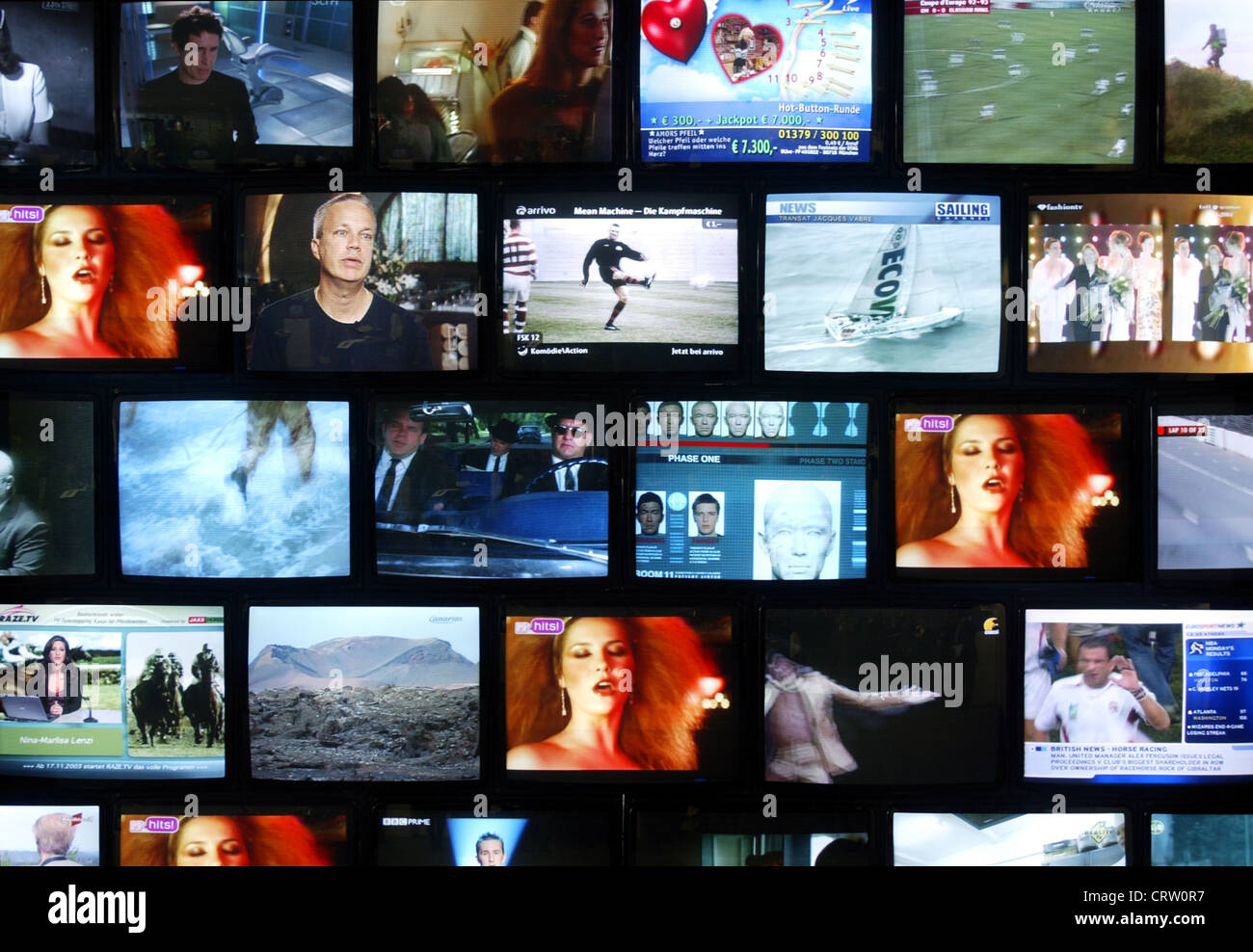 Monitor wall with various TV programs - Stock Image