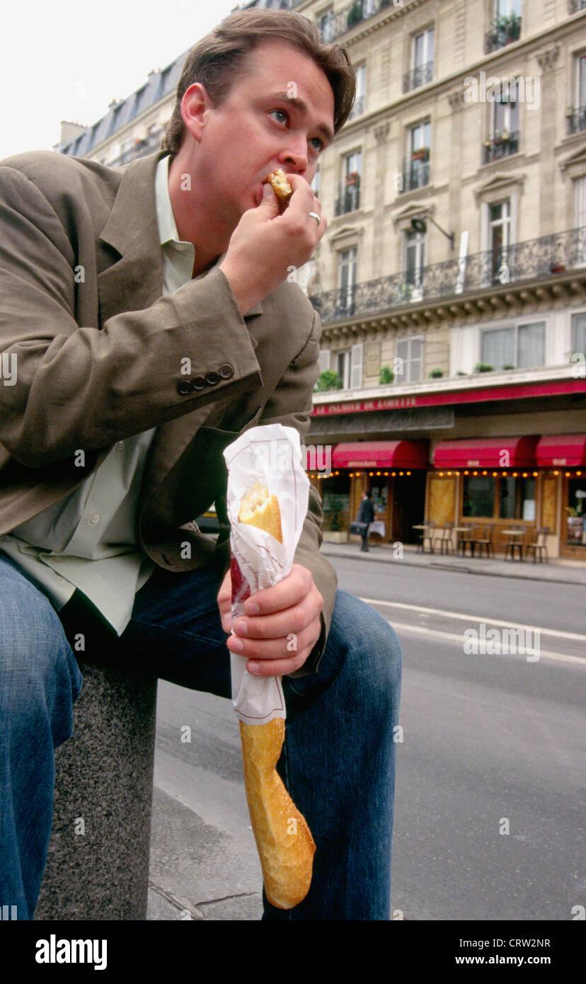 Baguette En Bois Decorative france man baguette stock photos & france man baguette stock