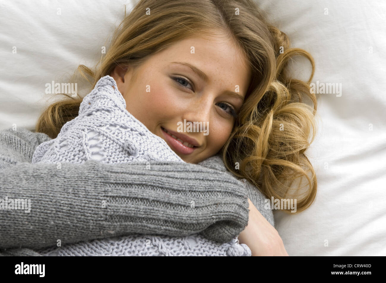 woman with cushion - Stock Image