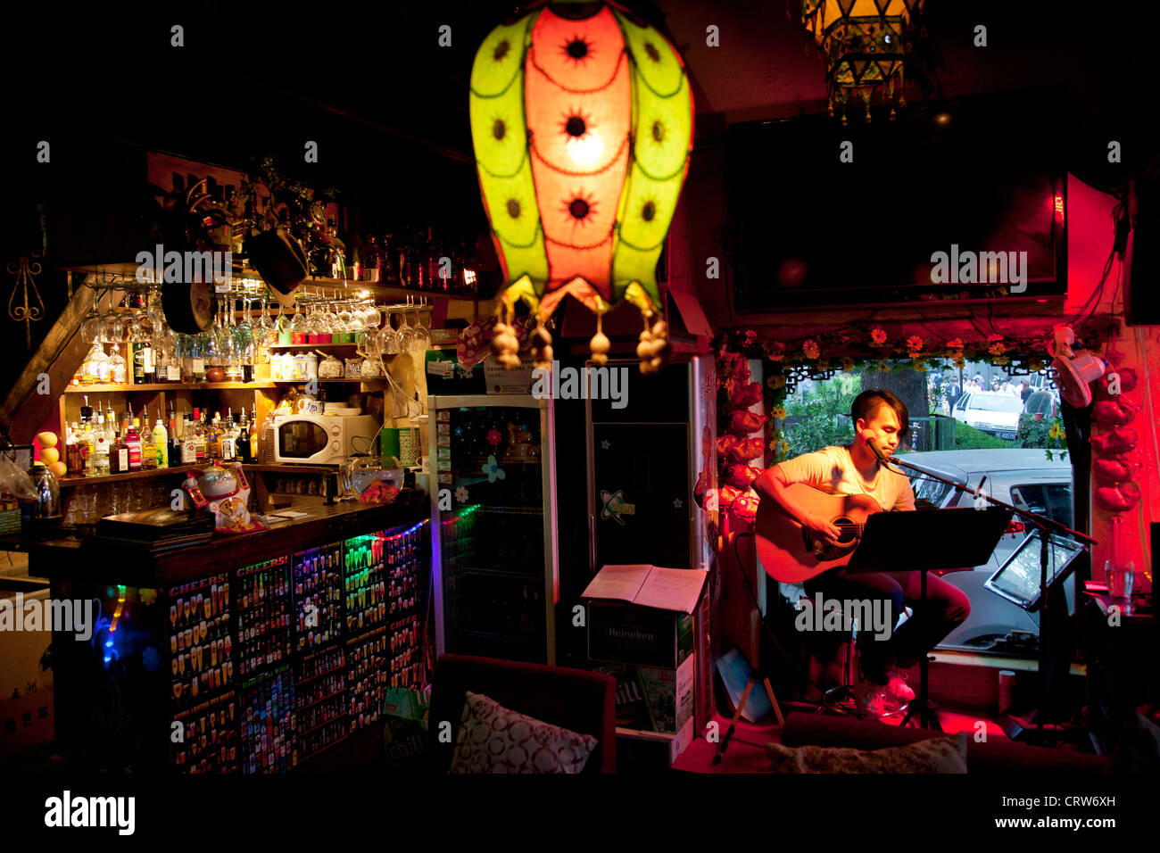 Singer performs at a bar in Shichahai, aka Houhai, Beijing's newly developed nightlife area, full of small bars. - Stock Image
