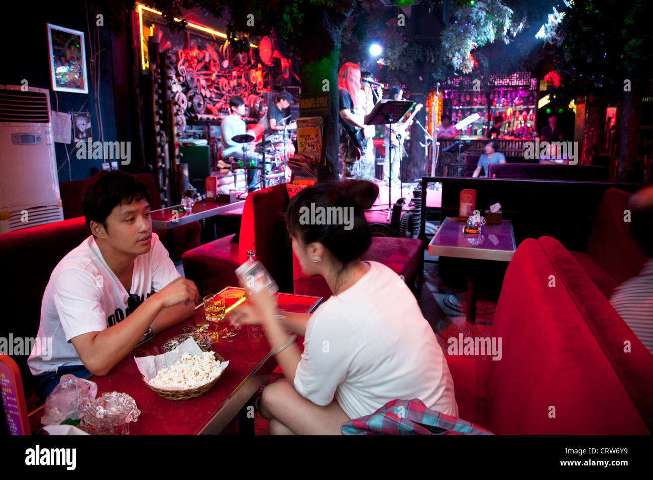 Couple at a bar in Shichahai, aka Houhai, Beijing's newly developed nightlife area, full of small bars. - Stock Image