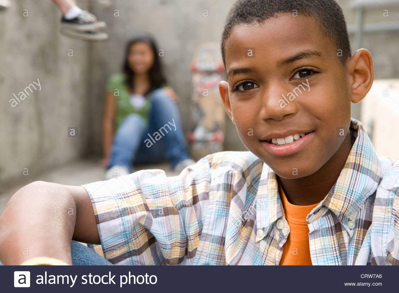 Boy (13-15) by friends, smiling, portrait, close-up - Stock Image