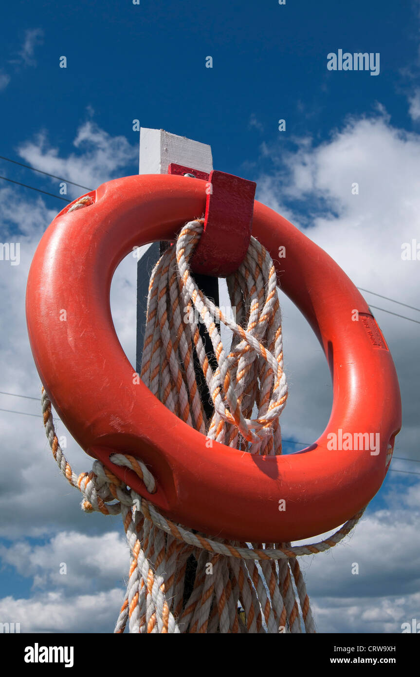 Life Saving Buoy Ring and rope at the canal side of Foxton Locks on the Grand Union Canal, Leicestershire, England - Stock Image