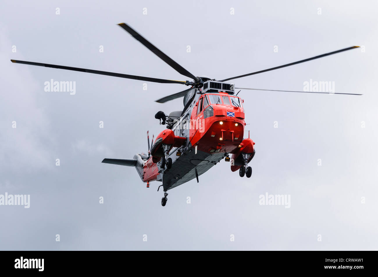 Royal Navy Sea King helicopter Rescue 177 in flight - Stock Image