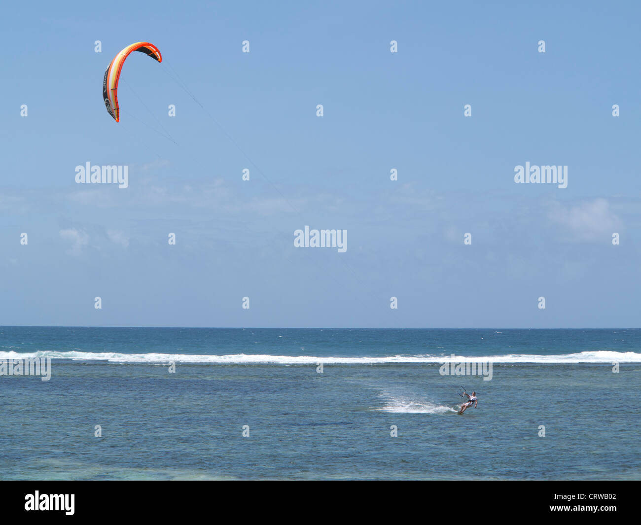 Tourist wind surfing on the beach at Tiwi, on Indian Ocean coast, Kenya - Stock Image