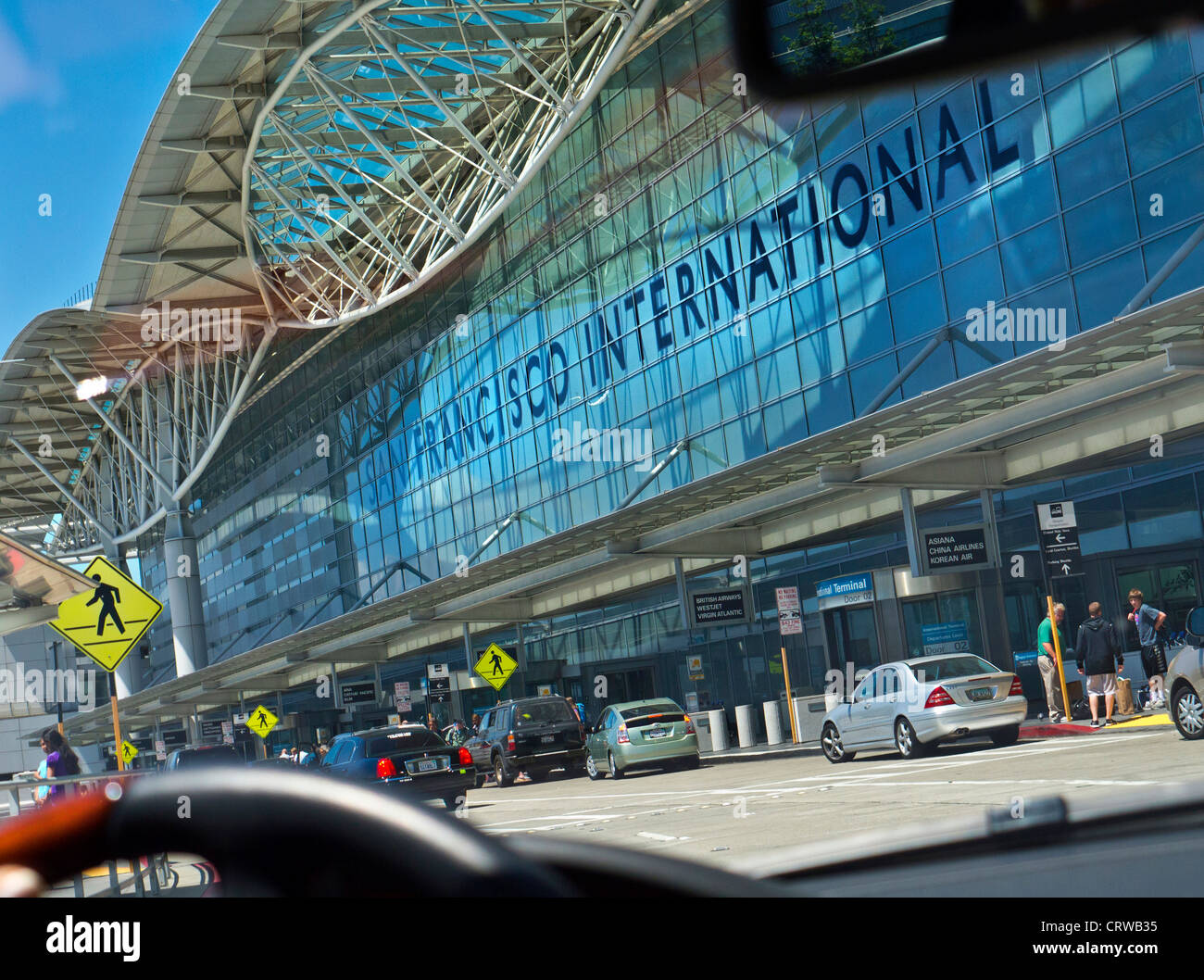 Limousine arriving at San Francisco departures terminal from car interior viewpoint San Francisco California USA - Stock Image