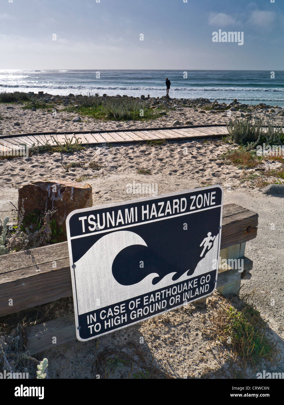 TSUNAMI SIGN CALIFORNIA Tsunami earthquake hazard zone sign on calm coastal 17 mile drive Pacific Grove Monterey - Stock Image