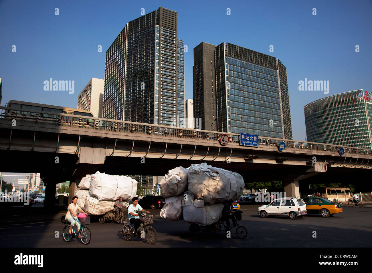 Banks and banking institutions along Financial Street are passed by commuters at a busy intersection, Beijing, China. - Stock Image