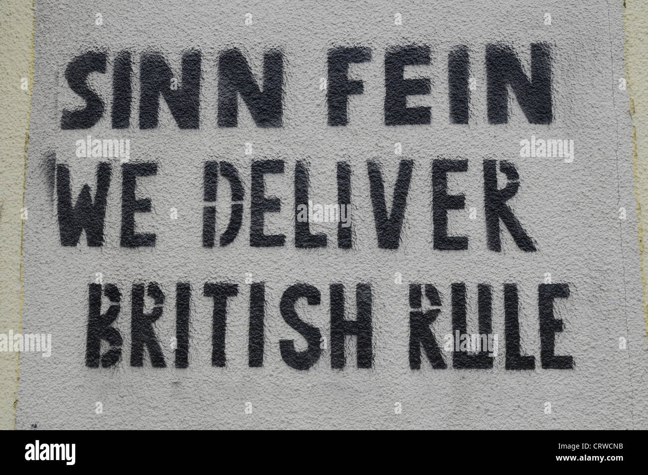 Sinn Fein we deliver British Rule, Graffiti sprayed on a wall in Newry, Co.Down, Northern Ireland - Stock Image