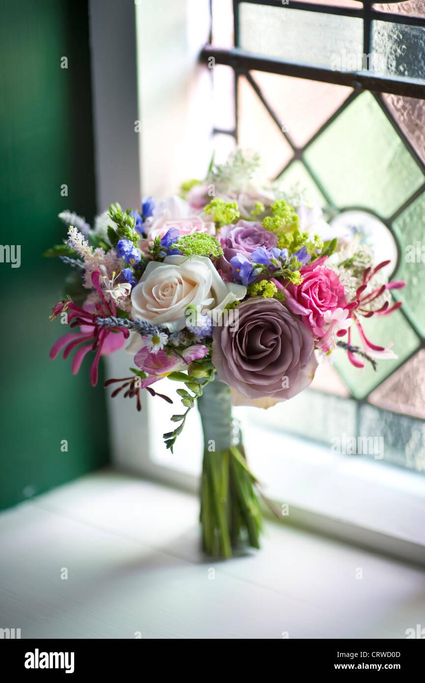 wedding bouquet of flowers near a window - Stock Image