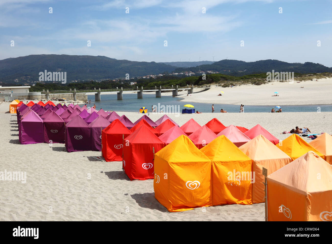 Colourful tents for changing on the beach , Vila Praia de Ancora , near Caminha, Minho Province, northern Portugal Stock Photo