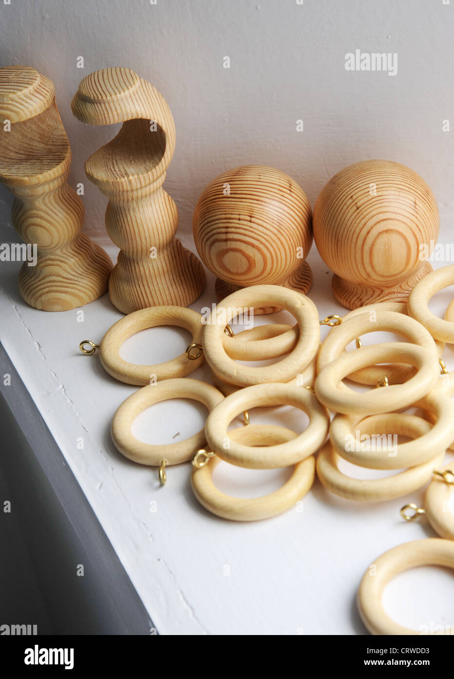 Wooden curtain rings and fixtures - Stock Image