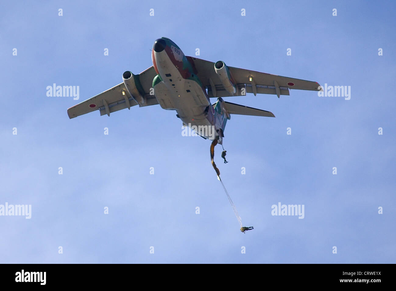 JGSDF 1st Airborne Brigade paratrooper is dropping from JASDF Kawasaki C-1 cargo aircraf - Stock Image