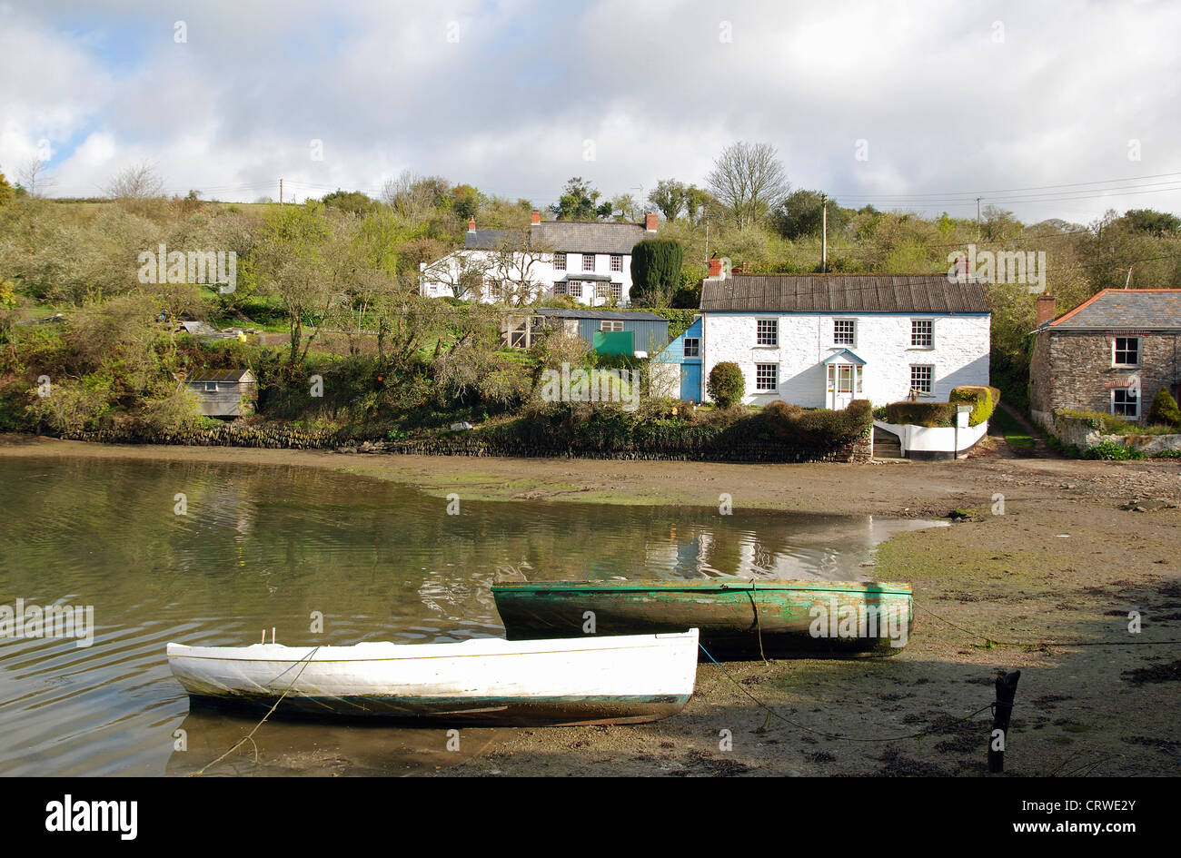The hamlet of Coombe on a tidal creek off the River Fal near Truro in Cornwall, UK - Stock Image