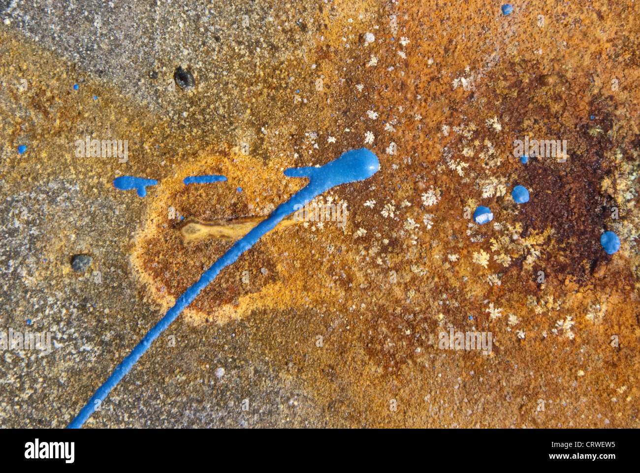 Blue splash of color on rusty steel plate Stock Photo