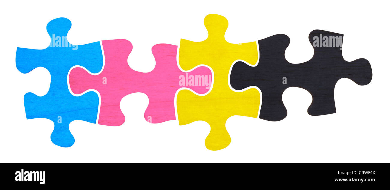 CMYK wooden jigsaw pieces - Stock Image