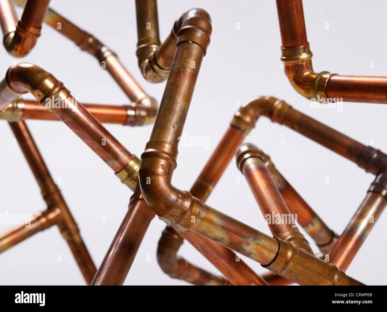 Jumble of copper pipe - Stock Image