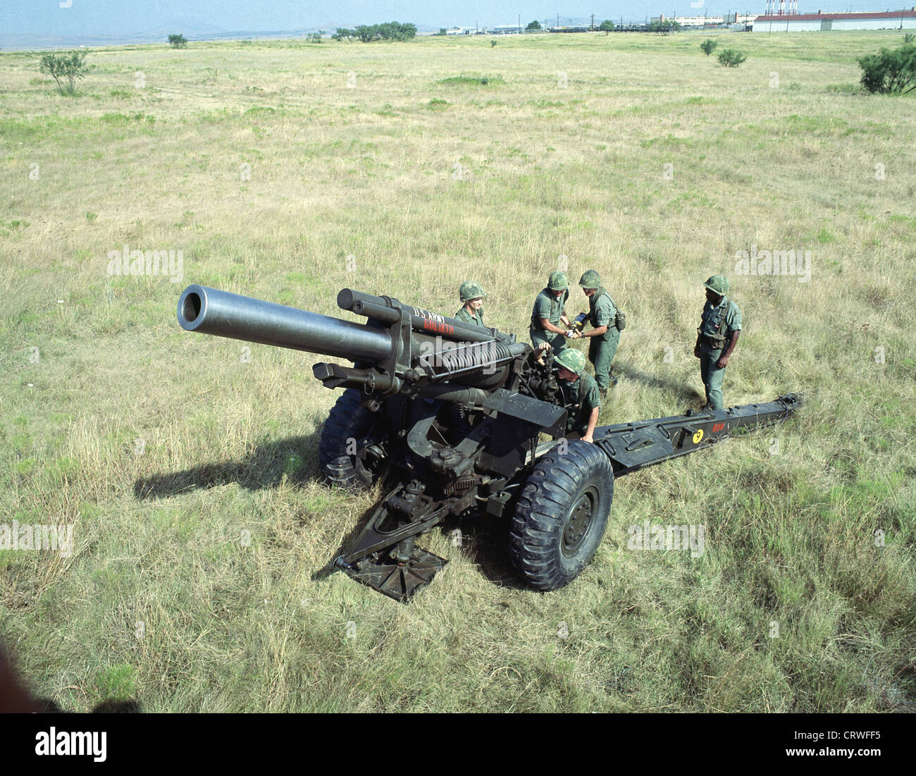 An M114 155 mm Howitzer in firing position. - Stock Image